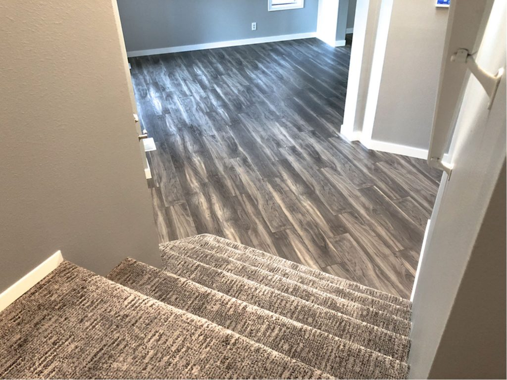 Stairs To Living Room Carpet And Luxury Vinyl Plank